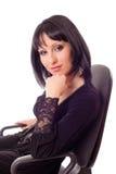 chair den sittande kvinnan Royaltyfria Bilder
