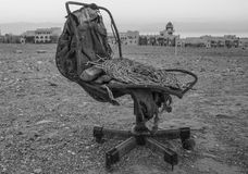 Old, ruined office chair in the desert royalty free stock images