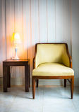Chair with desk lamp Stock Photos