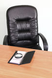 Chair and desk in the office. Chair and table with business card holders and a magnifying glass in the office stock photo