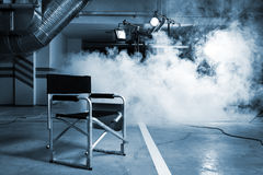 Chair for the director. In studio on a background of a smoke Stock Photo