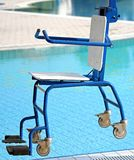 Chair for disabled people to make use of the pool for the handic Stock Photography