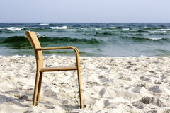 A chair on an empty beach Royalty Free Stock Images