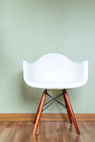 Chair in empty room against a green wall Royalty Free Stock Photos