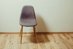Chair in the empty room. Chair stands near the wall in the empty room Royalty Free Stock Photos
