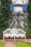 Chair with  European style window and flower. In garden Royalty Free Stock Photography