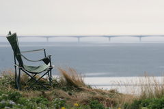 Chair face to Confederation Bridge,Canada Stock Images