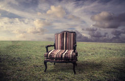 A chair in a field Royalty Free Stock Image