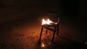 Chair on fire stock video footage