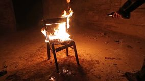 Chair on fire stock footage