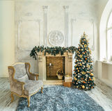 Chair Fireplace Christmas tree. Chair by the fireplace and Christmas tree in the interior studio Royalty Free Stock Images