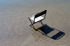 Chair for fisherman. Fisherman chair on the beach. The morning starts with joy royalty free stock photography