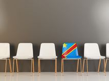 Chair with flag of democratic republic of the congo. In a row of white chairs. 3D illustration Stock Images