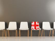 Chair with flag of georgia. In a row of white chairs. 3D illustration Royalty Free Stock Photo