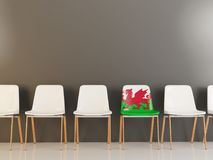 Chair with flag of wales. In a row of white chairs. 3D illustration Royalty Free Stock Images