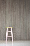 Chair on floor  with Laminate wall Stock Photography