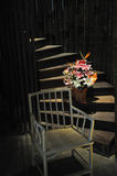 Chair,flowers and stairs Royalty Free Stock Photos