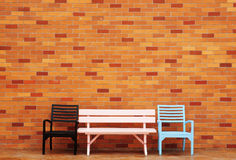Chair in front of a brick wall Royalty Free Stock Photos