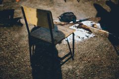 The chair is in front of the fire. The sun is shining in the mor stock images