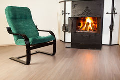 Chair in front of fireplace Stock Images