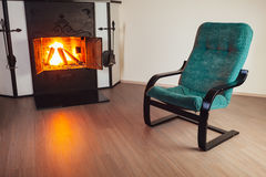 Chair in front of fireplace Royalty Free Stock Image