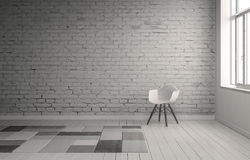 Chair in front of painted white brick wall Stock Photography
