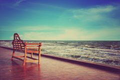Chair in front of the see under the evening sun light Royalty Free Stock Photo