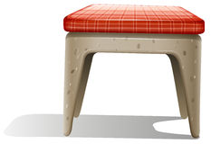 A chair furniture with a checkered pillow Royalty Free Stock Photo