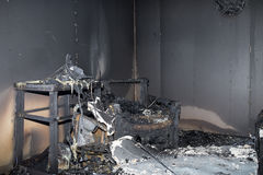 Chair and furniture in room after burned by fire in burn scene. Of arson investigation course stock photo
