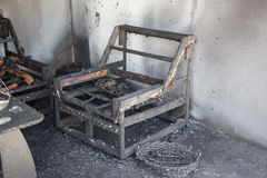 Chair and furniture in room after burned by fire in burn scene. Of arson investigation course stock images