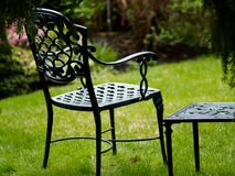 Chair in the garden. Iron chair in the garden Royalty Free Stock Photo