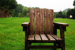 Chair in the garden. An arm chair on the meadow Royalty Free Stock Photos