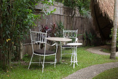 Chair garden on noon time Royalty Free Stock Image