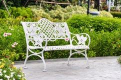 Chair in the garden. Stock Photos