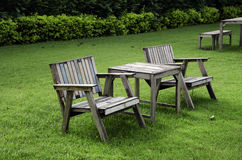 Chair in the garden. Wooden chairs in the lawn Stock Photography