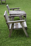 Chair in the garden. Wooden chairs in the lawn Stock Photos