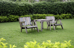 Chair in the garden. Wooden chairs in the lawn Royalty Free Stock Photography