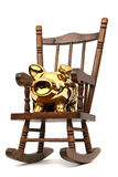 Chair and golden piggy bank Royalty Free Stock Photo