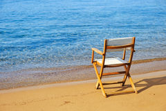 Chair on a golden sandy beach Stock Photos