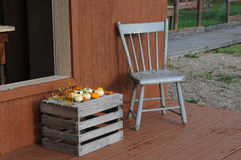 Chair and gourds. Chair by a milk crate with gords Royalty Free Stock Photo