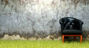 Chair grass old crumbling wall Stock Images