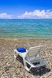 Chair at greek beach Stock Photo