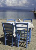 Chair in greek taverna Stock Images