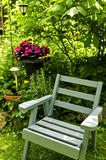 Chair in green garden stock photography