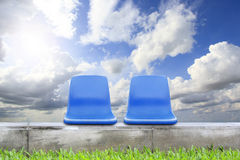 Chair on green grass and blue sky Royalty Free Stock Photo