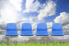 Chair on green grass and blue sky Royalty Free Stock Photos