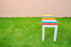 Chair on green grass -  Wooden Bench in the garden Stock Images