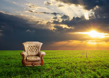 Chair on a green meadow. Concept design Stock Images