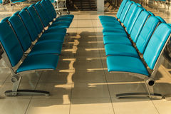 Chair in the hall of airport Stock Photography