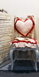 Chair with a heart pillow Royalty Free Stock Image